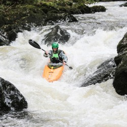 Kayakers negotiating the falls at Henllan Bridge on the River Teifi | © Iestyn Hughes