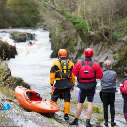 Kayaking the grade 4 Falls at Cenarth on the River Teifi | © Iestyn Hughes